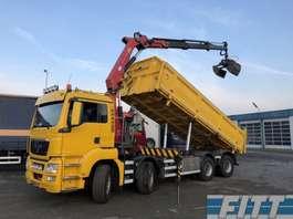 kipper vrachtwagen MAN TGS 41.440 EEV 8X4 HMF 18 tm kraan 3-zijdkipper 2010