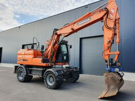 wielgraafmachine Doosan DOOSAN DX140W 3   HIDRAULIC ROTATED UTILTY 2013