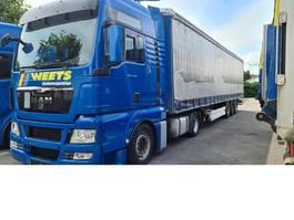 mega-volume vrachtwagen MAN TGX 18.440 LLS + 3-Achs Schmitz EZ 2008 2013
