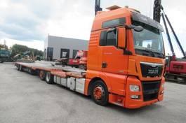 autotransporter vrachtwagen MAN TGX 26.440 6x2  en  Polkon TS-802 oprijwagen 2014