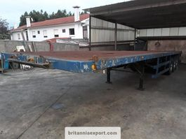 platte oplegger Fruehauf 3 axle trailer on springs with twists locks for containers. 1990